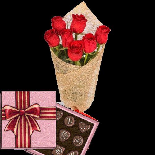 фото 7 красных роз с конфетами