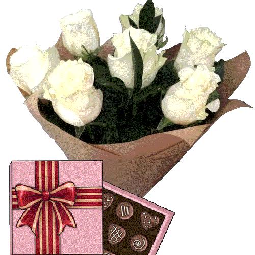 Фото товара 7 білих троянд і цукерки